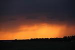 Západ slunce pod bouřkou - autor: