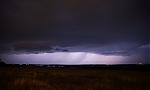 Srážkové pruhy noční bouřky osvícené bleskem - autor: Michal Janoušek